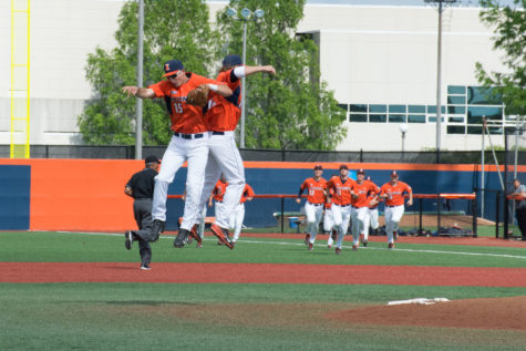 Illini first baseman David Kerian and third baseman Ryne Roper celebrate Illinois' victory over Wright State at Illinois Field on June 1.