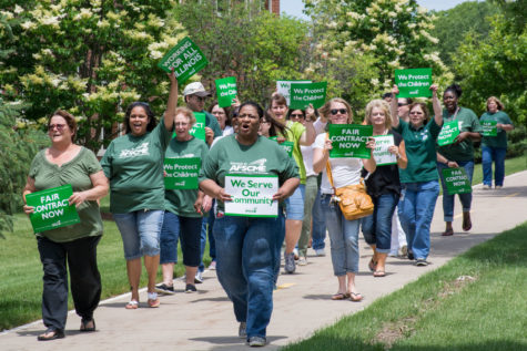 State employees rally and march in support of public services along S. First Street in Champaign on Wednesday, June 10.