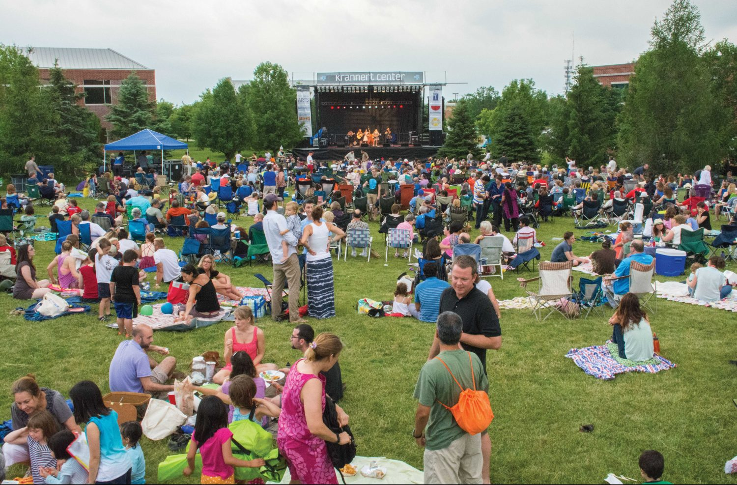 A crowd gathers to enjoy a concert at Outside at Research Park. This festival is one of many that contributes to Champaign-Urbana's vibrant culture.
