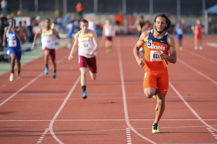 Illinois%27+DJ+Zhan+crosses+the+finish+line+to+win+the+4x100+meter+relay+during+the+Illinois+Twilight+Track+and+Field+meet+at+Illinois+Soccer+and+Track+Stadium+on+Saturday%2C+April+12%2C+2014.