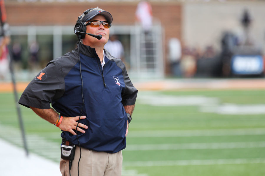 Illinois+head+coach+Tim+Beckman+watches+a+replay+after+a+referee%27s+call+during+the+game+against+Youngstown+State+at+Memorial+Stadium+on+Saturday%2C+Aug.+30%2C+2014.+The+Illini+won+28-17.