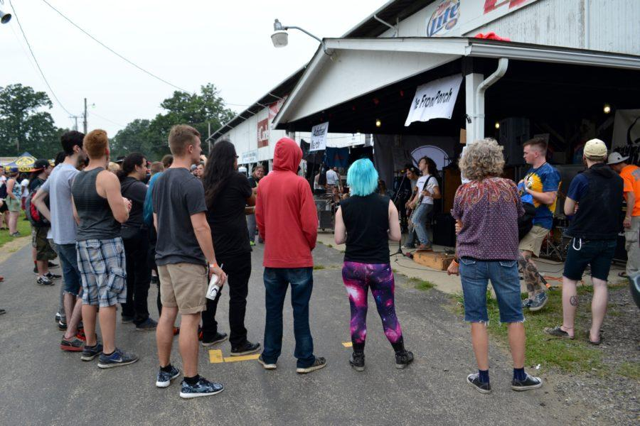 Fans gather to listen to a variety of bands at the ChampaignCounty Fairgrounds in Urbana for AudioFeed Music Festival on Friday, July 3.