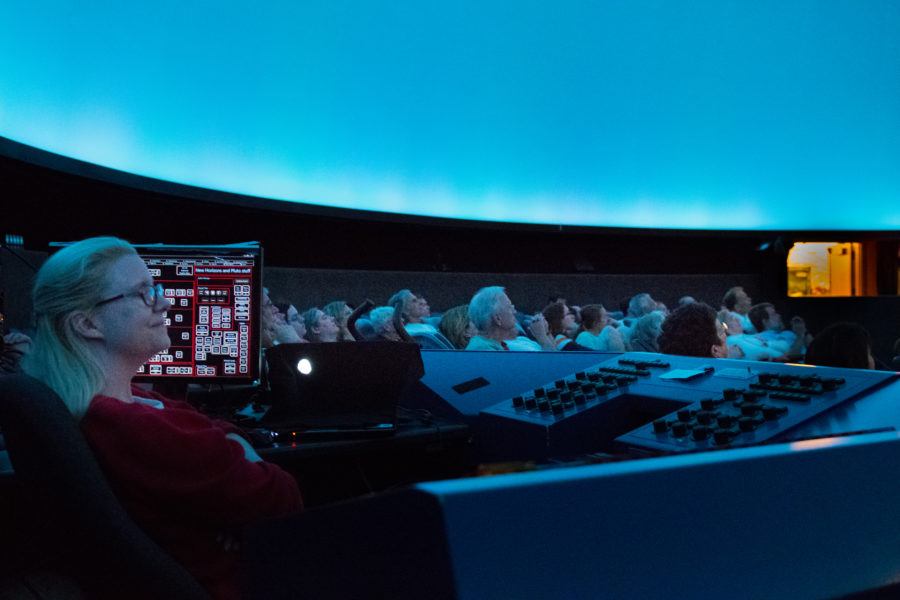 Staerkel Planetarium at Parkland College hosted an open house-style event for attendees to view a live stream of the New Horizons control room for confirmation of its flyby mission on Tuesday.