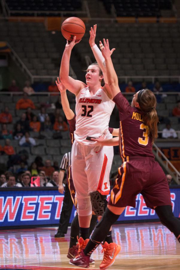 Illinois' Chatrice White (32) goes for a contested jump shot during the match against Minnesota at the State Farm Center on Thursday, Feb. 5, 2015.