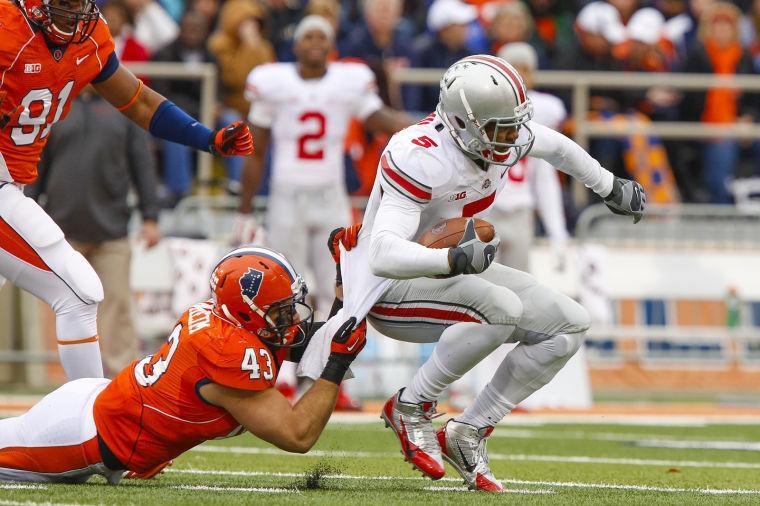 Illinois' Mason Monheim (43) tackles Ohio State's Braxton Miller (5) during the game at Memorial Stadium in Champaign, Ill. on Saturday, Nov. 16, 2013. The Illini lost, 60-35.