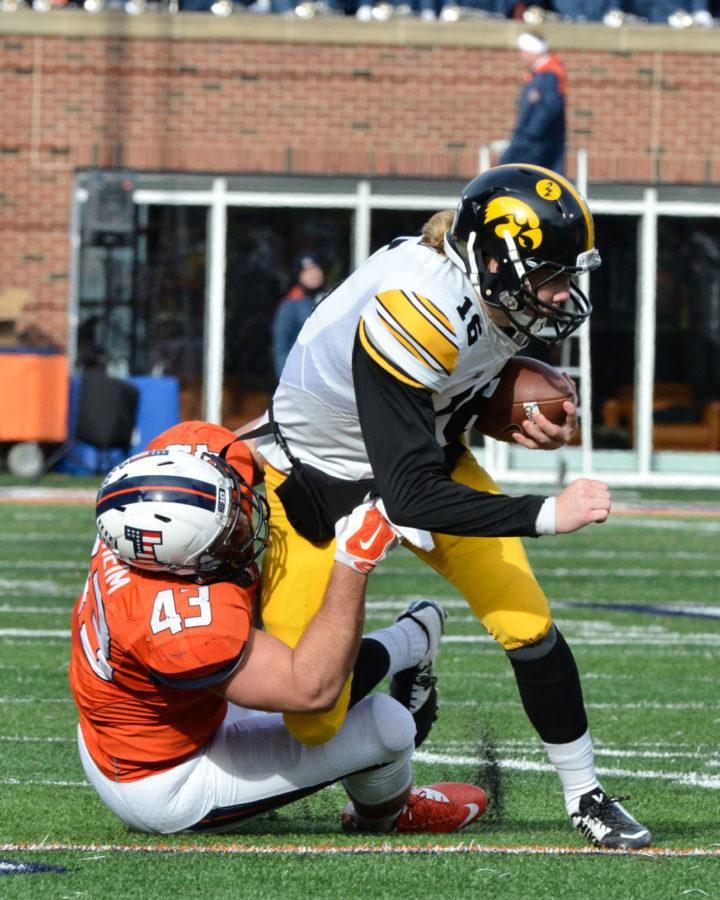 Illinois' Mason Monheim tackles Iowa's C.J. Beathard during a game at Memorial Stadium on Nov. 15. Monheim enters his senior year with a spot on multiple preseason watch lists.