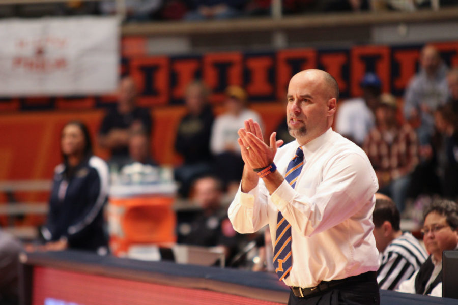 Illinois head coach Matt Bollant applauds his teams performance during the Illini's 89-37 win over Mariam at Assembly Hall, on Oct. 30, 2012.
