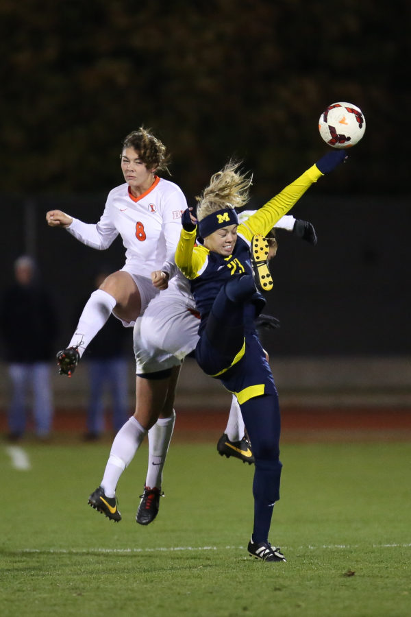 Illinois%27+Casey+Conine+%288%29+and+Amy+Feher+%2824%29+clash+with+Michigan%27s+Chloe+Sosenko+%2823%29+for+a+header+during+the+game+against+Michigan+at+Illini+Soccer+and+Track+Stadium+on+Friday%2C+Oct.+25.+The+Illini+lost+2-0.