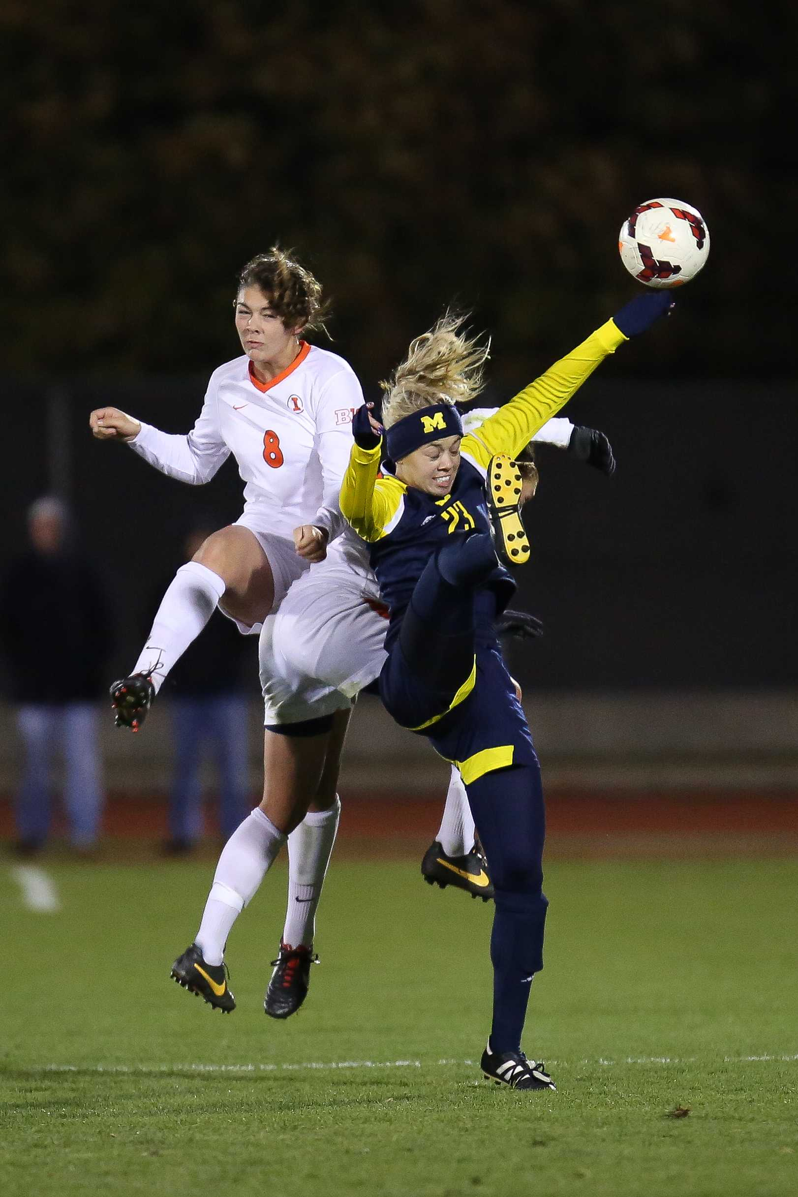 Illinois' Casey Conine (8) and Amy Feher (24) clash with Michigan's Chloe Sosenko (23) for a header during the game against Michigan at Illini Soccer and Track Stadium on Friday, Oct. 25. The Illini lost 2-0.