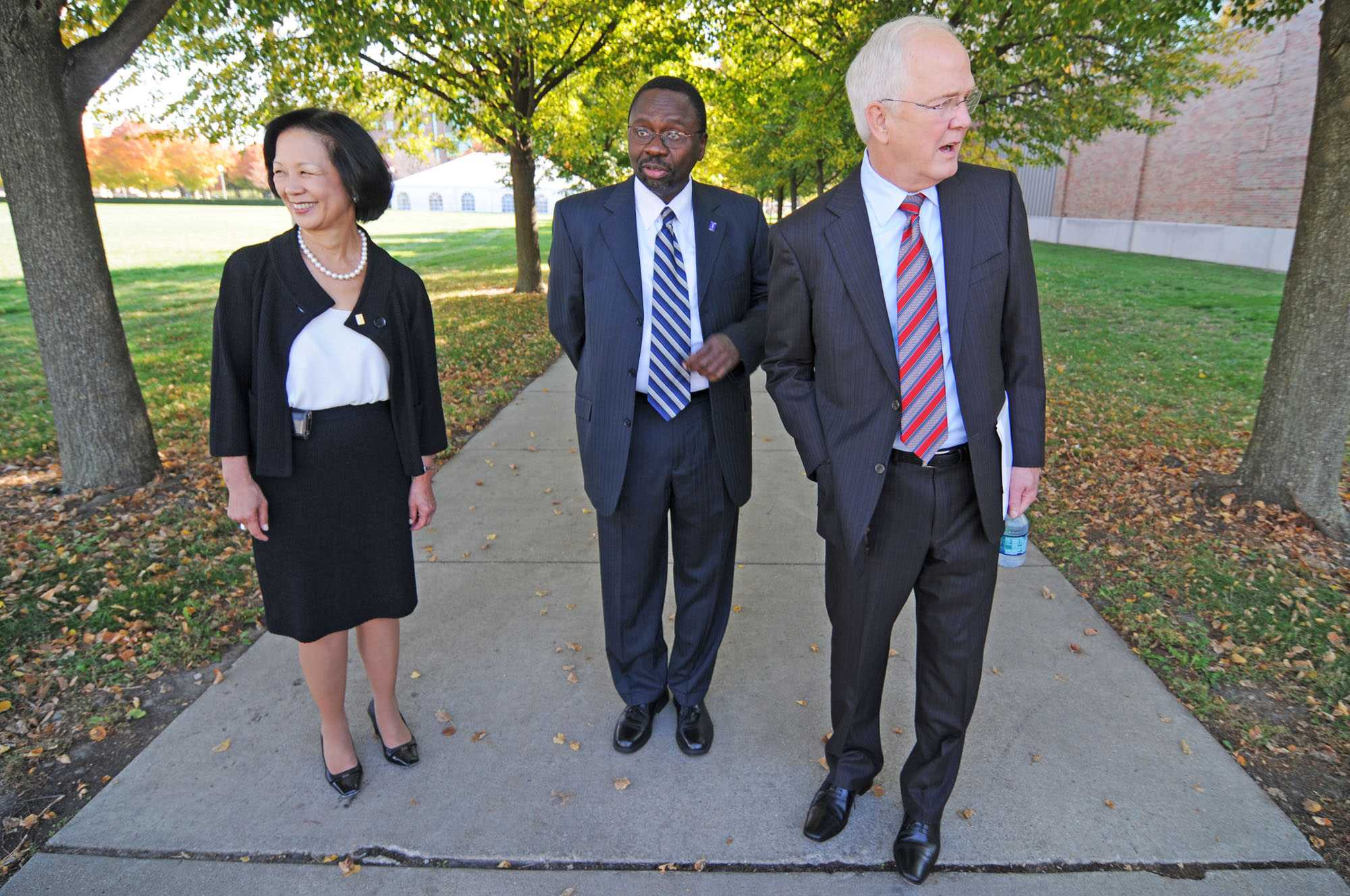From left to right, Phyllis Wise, UI Chancellor, Ilesanmi Adesida, Dean of the College of Engineering, and Michael Hogan, UI President, wait for governor Pat Quinn's car to arrive before the ground breaking for the new Electrical and Computer Engineering building on Friday, Oct. 7, 2011.