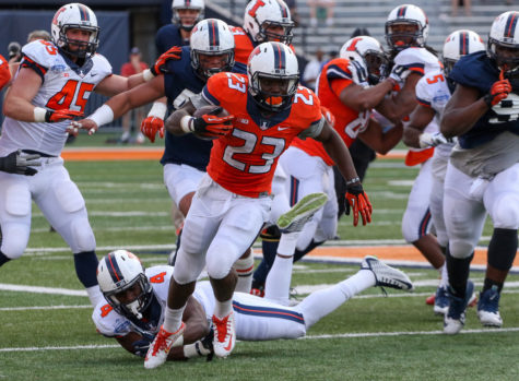 Illinois' Henry Enyenihi (23) runs the ball down field during the annual football Spring Game at Memorial Stadium on Saturday, Apr. 18, 2015. The Orange won 44-41.