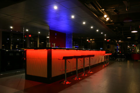 The bar at Venue 51, which is colored by an array of lights, is now opening to the public for Wednesday night drink specials. Previously, the bar was known for hosting private parties.
