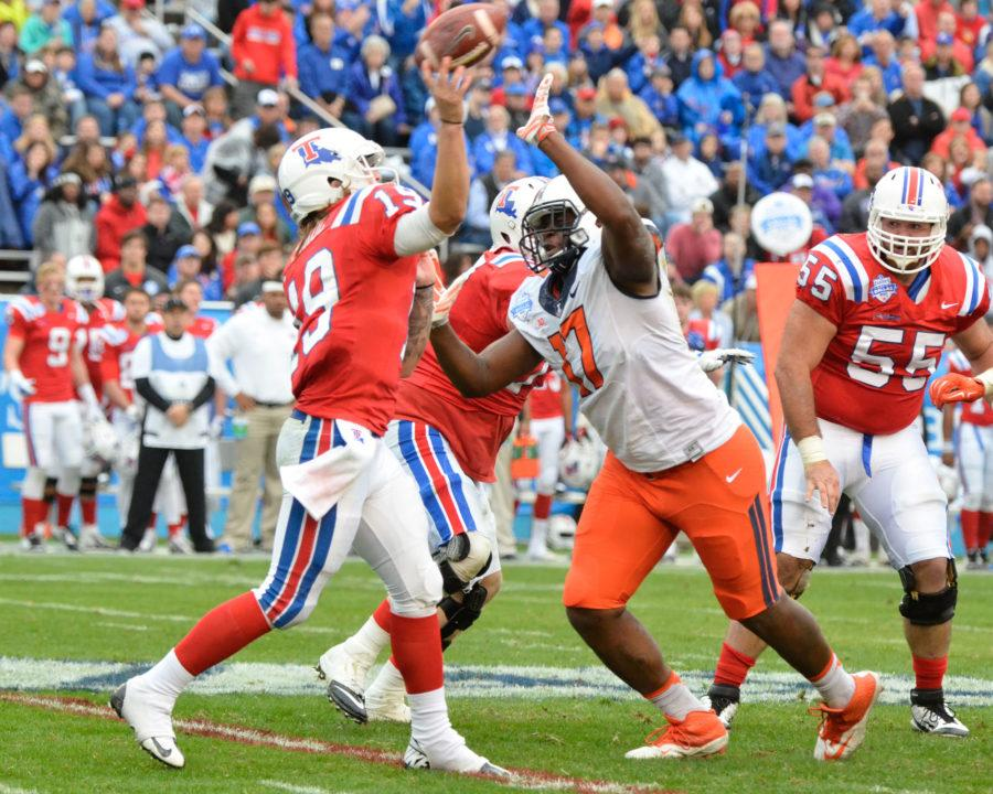 Illinois' Jihad Ward (17) attempts to block Louisiana Tech's Cody Sokol's (19) pass during the Zaxby's Heart of Dallas Bowl at Cotton Bowl Stadium in Dallas, Texas on Friday, Dec. 26, 2014. The Illini lost 35-18.