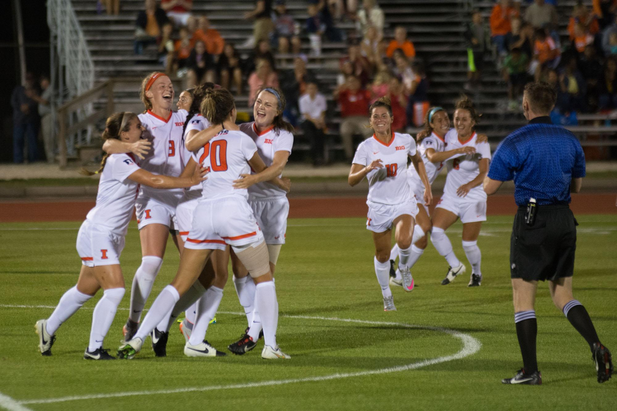 Illinois players celebrate after a goal during Friday's win over TCU.