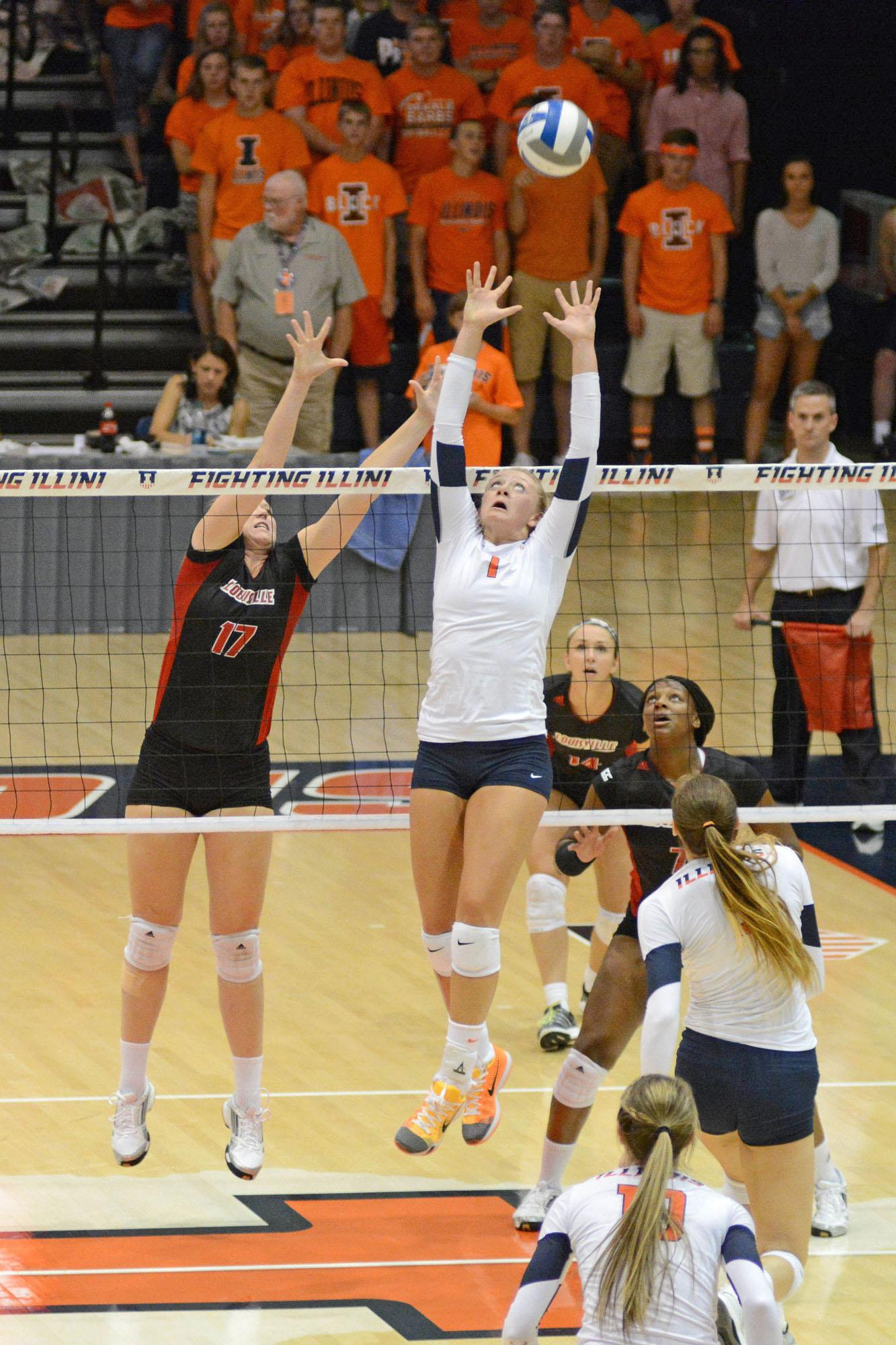 Illinois' Jordyn Poulter (1) sets the ball during the game vs Louisville  at Huff Hall on Friday, Aug. 28, 2015.  Illinois won 3-0.