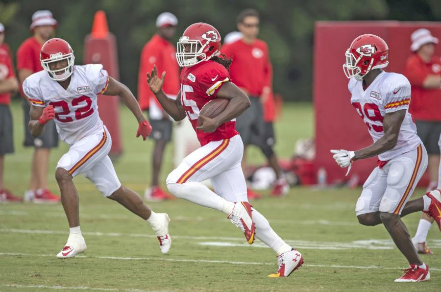 Kansas City Chiefs running back Jamaal Charles (25) splits the defense of cornerback Marcus Peters (22) and free safety Husain Abdullah (39) during the team's training camp practice at Missouri Western State University in St. Joseph, Mo., on Tuesday, Aug. 4, 2015.