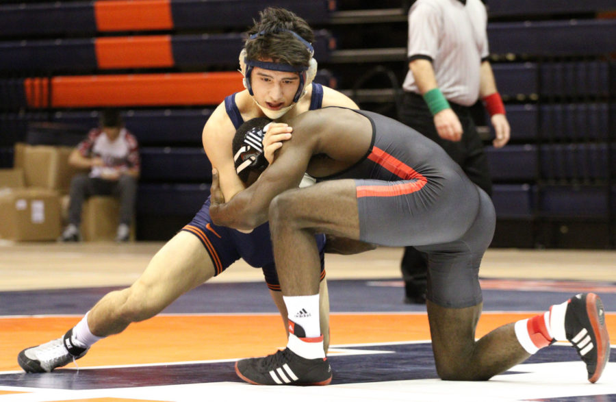 Illinois' Isaiah Martinez attempts to bring down Nebraska's James Green during the wrestling match vs. Nebraska at Huff Hall on Jan. 23. The Illini lost 22-9.