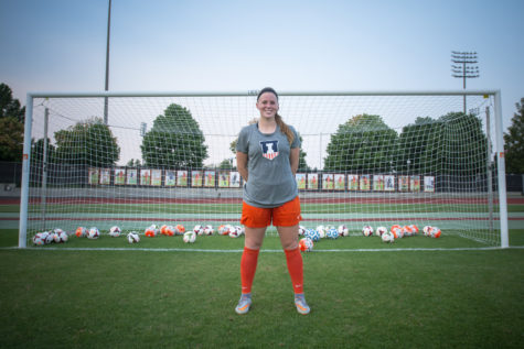 Jannelle Flaws stands with 50 balls representing the record-setting 50 goals she has scored over her Illinois career.