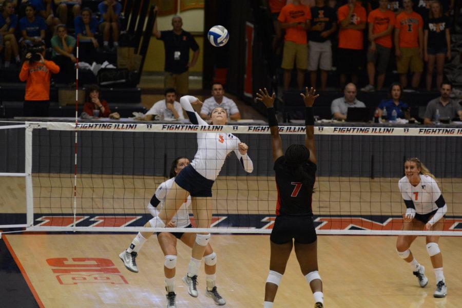 Illinois' Ali Bastianelli (5) attempts to spike the ball during the game vs Louisville  at Huff Hall on Friday, Aug. 28, 2015.  Illinois won 3-0.