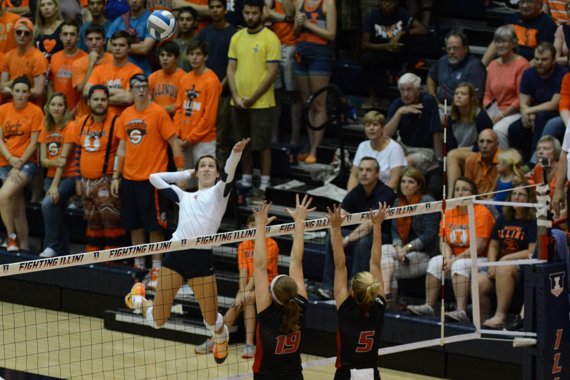 Illinois' Michelle Strizak (4) attempts to spike the ball during the game versus Louisville at Huff Hall on Friday, August 28, 2015.The Illini won 3-0.