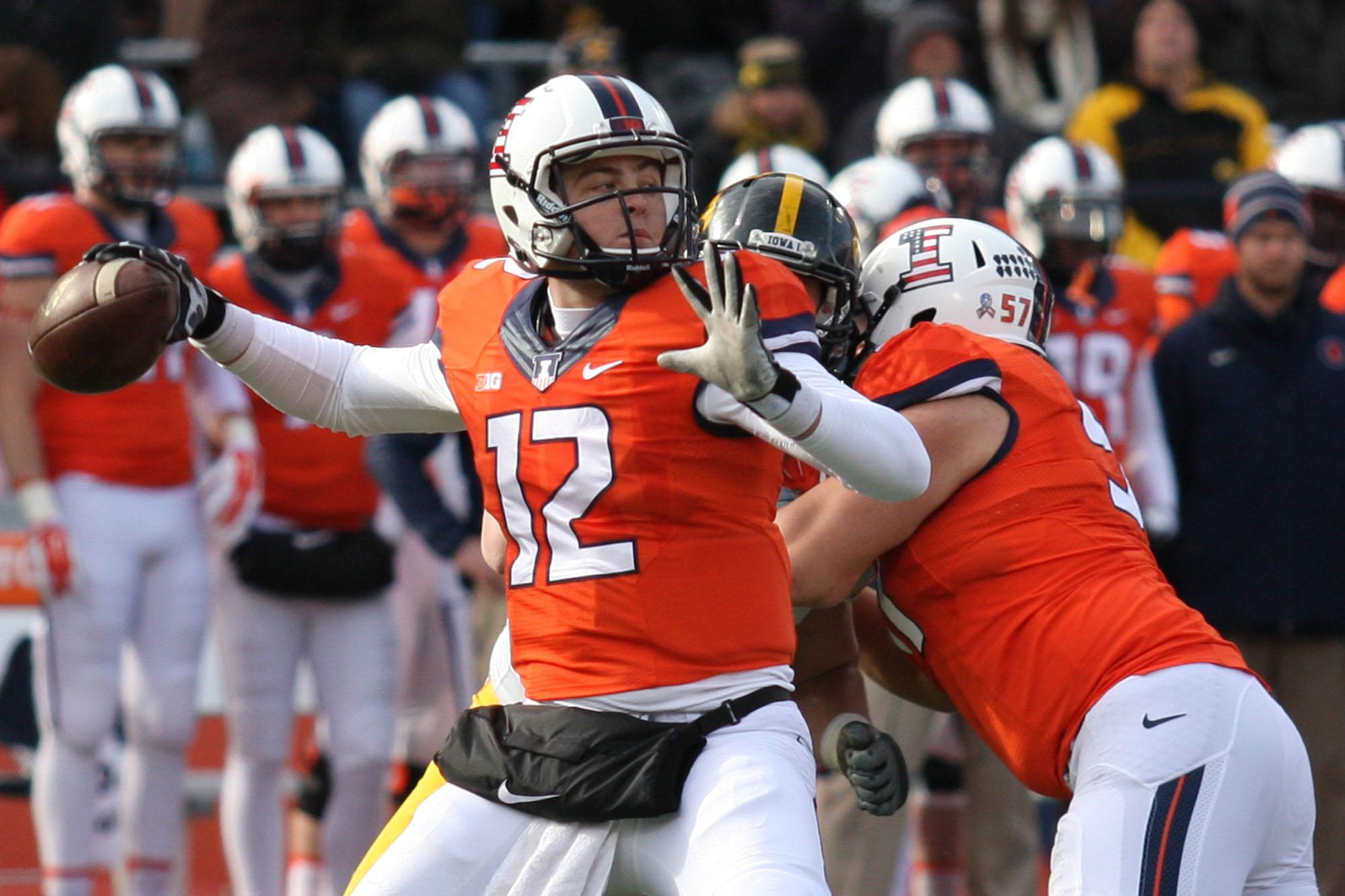 Illinois' Wes Lunt (12) looks for an open pass during the game against Iowa at Memorial Stadium on Saturday, Nov. 15, 2014. Illinois lost 30-14.
