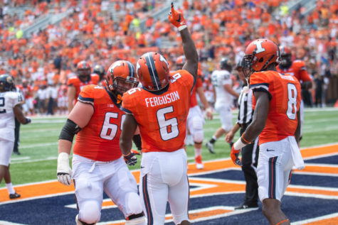 Illinois running back Josh Ferguson celebrates after scoring a touchdown in the game against Kent State at Memorial Stadium on Saturday, September 5.