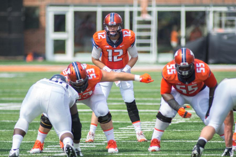 Wes Lunt prepares for a snap during Illinois' 52-3 victory over Kent State in their season-openerat Memorial Stadium on Saturday, September 5.