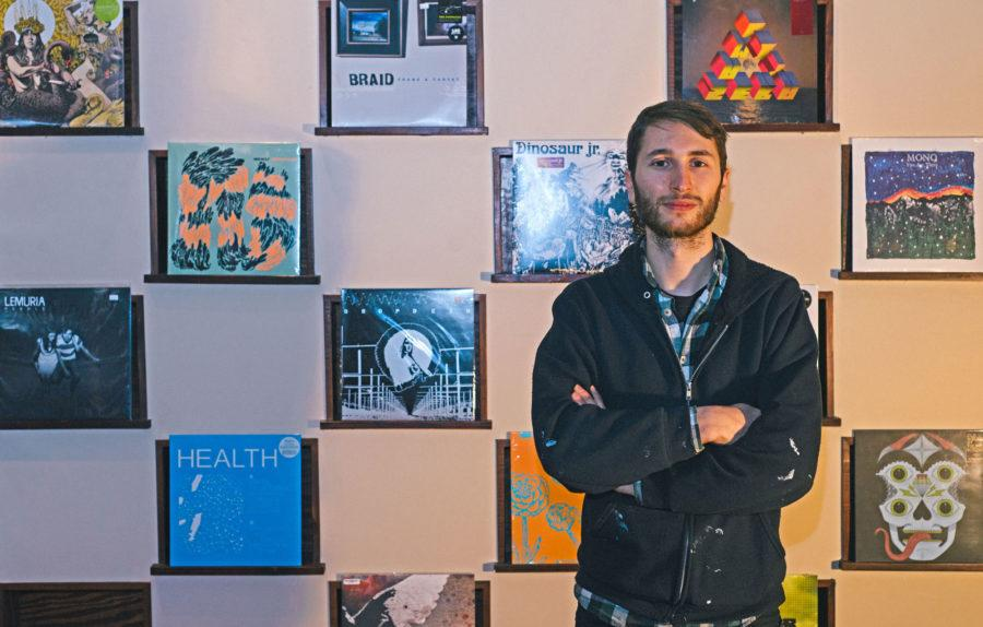 Portrait by Zach Dalzell The Daily IlliniNathan Landolt, 27, stands in front of a few of his records at Error Records, still under construction. Error Records will be an all ages music venue as well as a venue for other forms of art.