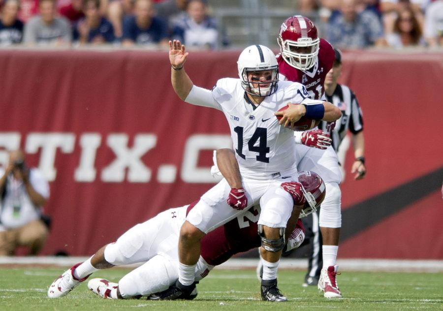Penn State quarterback Christian Hackenberg is sacked by Temple defenders Saturday, Sept. 5, 2015 game against Temple at Lincoln Financial Field in Philadelphia, Pa. Temple won 27-10. (Abby Drewy/Centre Daily Times/TNS)