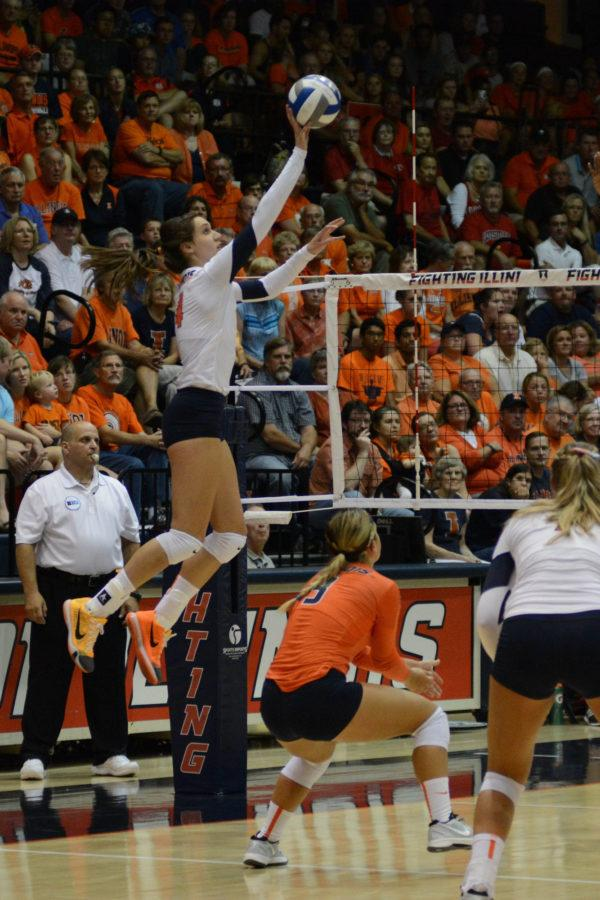 Illinois' Michelle Strizak (4) attempts to dink the ball during the game versus Louisville at Huff Hall on Friday, August 28, 2015.The Illini won 3-0.