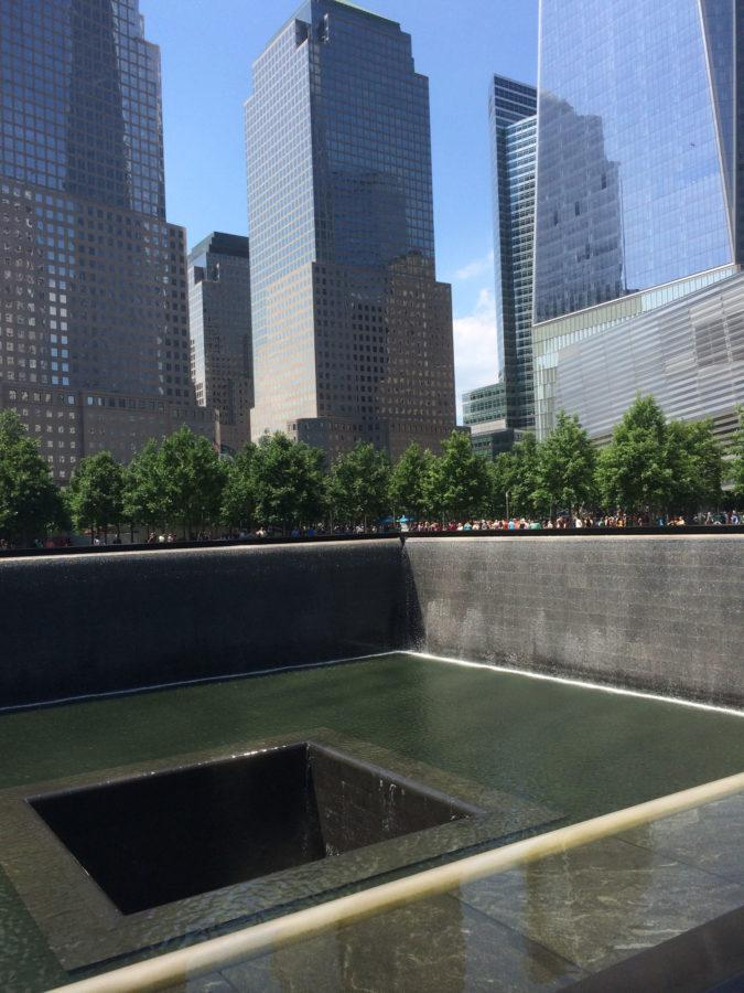 Visitors gather around the National September 11 Memorial in July in New York City. The memorial features two twin reflective pools that stand where the World Trade Center's Towers once did.