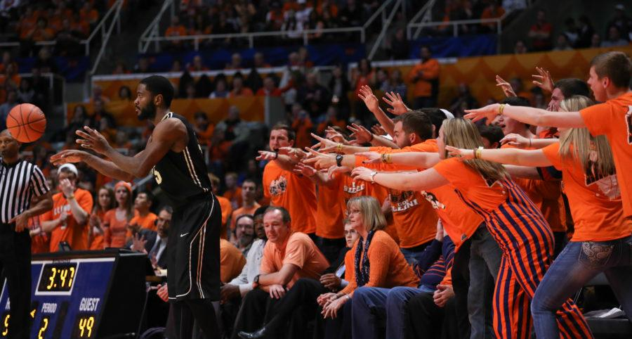 Member's of the Orange Krush attempt to distract Rapheal Davis (35) while he inbounds the ball during the game against Purdue at State Farm Center on Jan. 21, 2015. The Illini won 66-57.