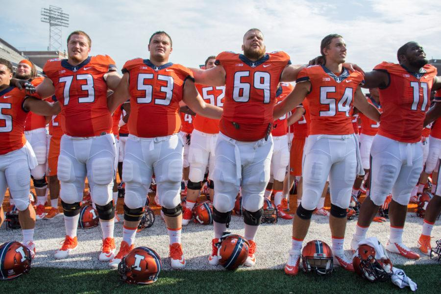 Nick Allegretti (53) celebrates Illinois' win over Kent State with Chris O'Connor (73) and Ted Karras (69) Zach Hirth (54) and Chunky Clements (11). Allegretti switched from offensive to defensive line prior to the Illini's game against Western Illinois.