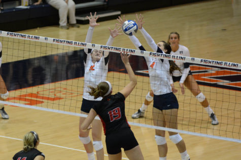 Illinois' Katie Stadick (12) and Jocelynn Birks (7) attempt to block Louisville's hit during the game vs Louisville  at Huff Hall on Friday, Aug. 28, 2015.  Illinois won 3-0.