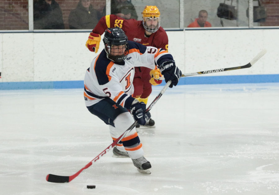 Illinois' Joey Caprio goes for a pass during round one of the CSCHL hockey tournament v. Iowa State at the Ice Arena on Friday, Feb. 20, 2015. Illinois won 2-1.