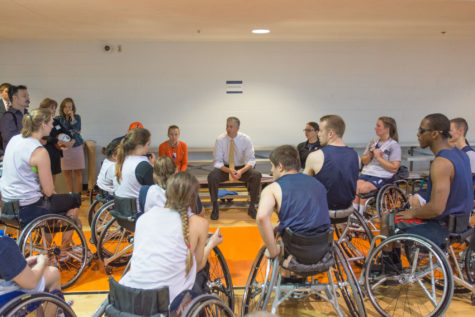 U.S. Secretary of Education Arne Duncan talks with members of the University's wheelchair basketball team Wednesday morning at the ARC.