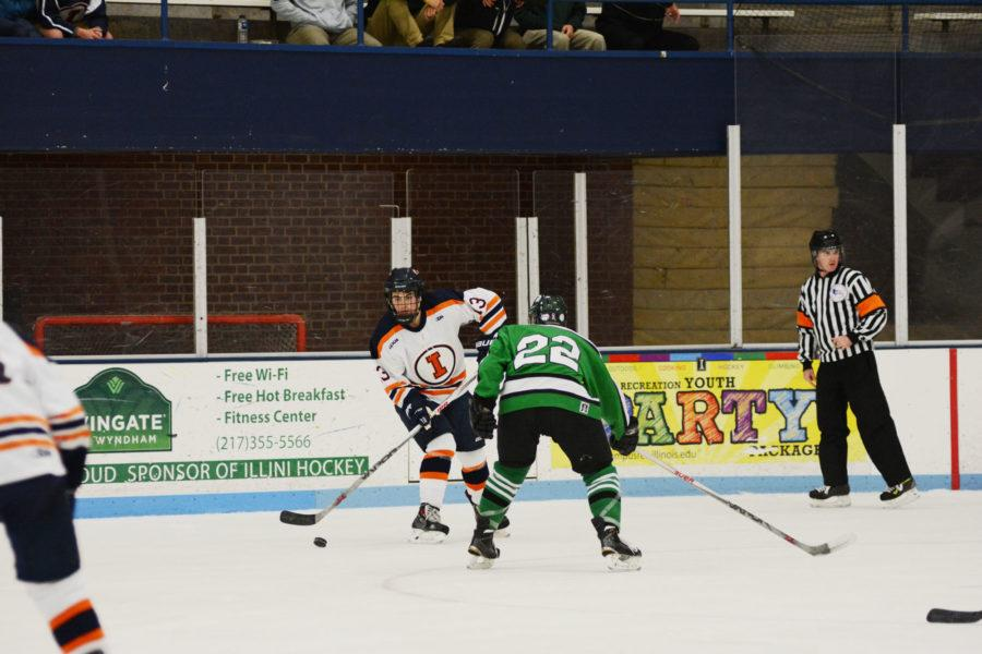 James Mcging (13) looks for an opening during the game against Michigan State at the University of Illinois Ice arena on September 19, 2015.