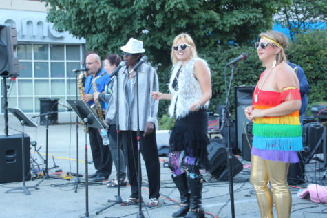 Reca.Sto, a multimedia arts imprint band, performs at Champaign's 2015 Pride Parade on Saturday.