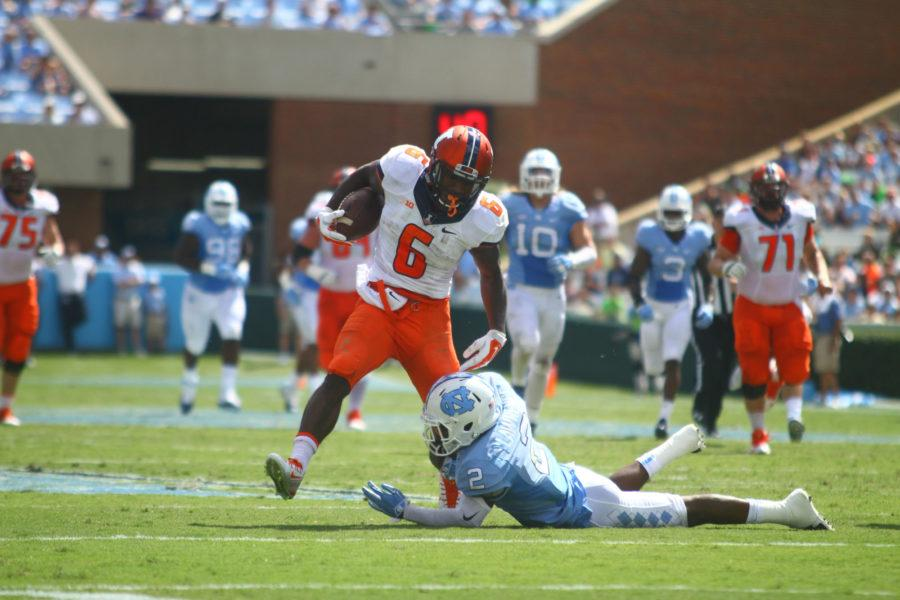 North Carolina's Des Lawrence tries to tackle Illinois' Josh Ferguson during the Illini's 48-14 loss to the Tar Heels on Saturday at Kenan Stadium in Chapel Hill, North Carolina. | Photo by Wyatt McNamera, The Daily Tarheel