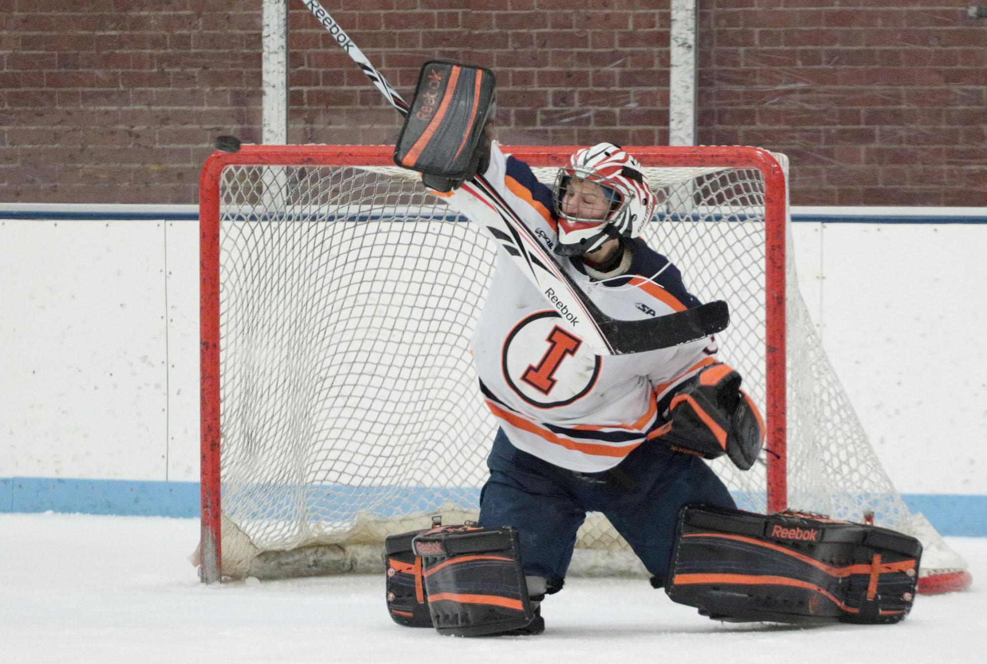 Illinois' Joe Olen (31) deflects a shot away from the goal during round one of the CSCHL hockey tournament v. Iowa State at the Ice Arena on Friday, Feb. 20, 2015. Illinois won 2-1.