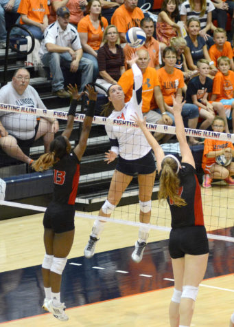 Illinois' Ali Stark (13) spikes the ball during the game vs Louisville  at Huff Hall on Friday, Aug. 28, 2015.  Illinois won 3-0.