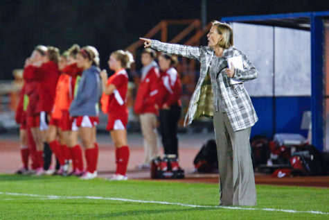 Illinois' head coach Janet Rayfield instructs her team during the game against No. 20 Wisconsin at the Illini Soccer and Track Stadium on Saturday, Oct. 12, 2013.