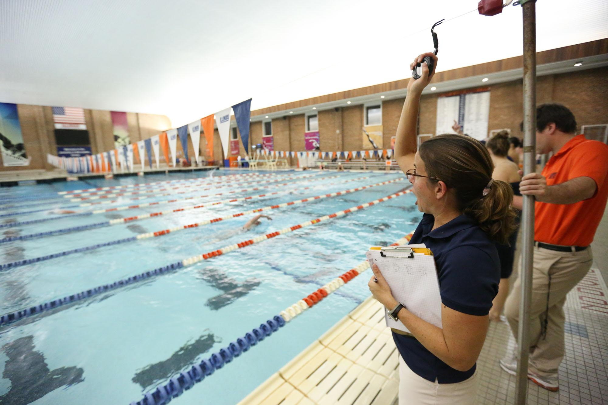 Illinois' head coach Sue Novitsky cheers on her swimmers during the meet against Illinois State at the ARC, on Friday, Nov. 1, 2013. The Illini won 206-94.