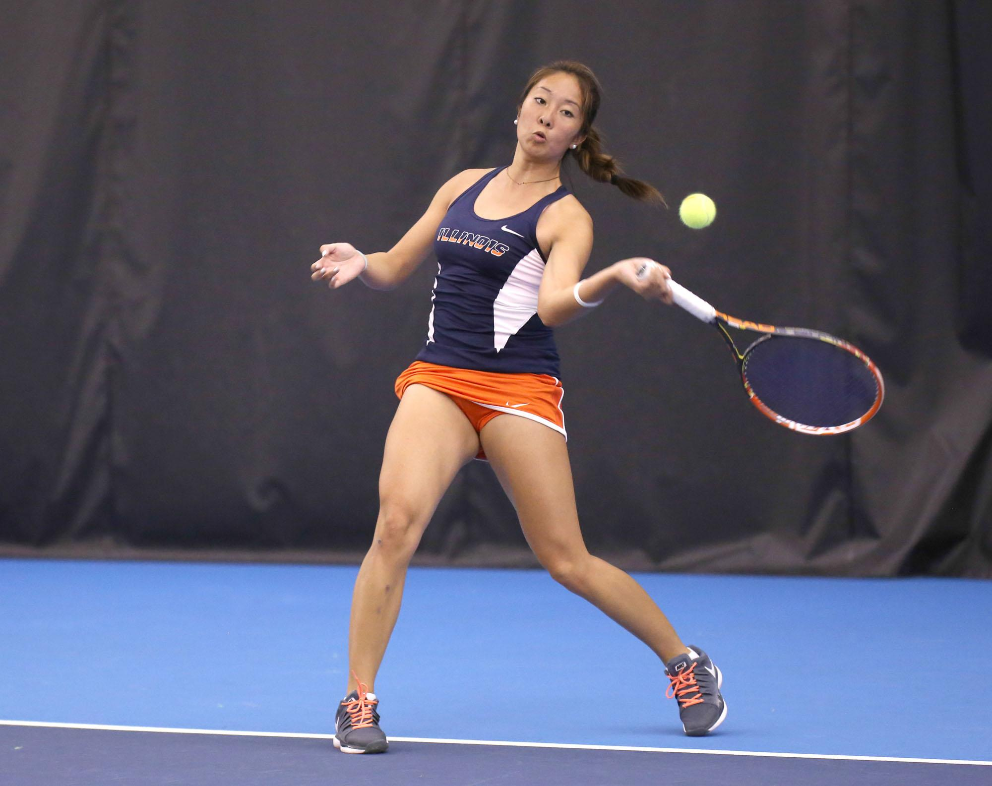 Illinois' Louise Kwong attempts to return the ball during the meet against UIUC at Atkins Tennis Center on Jan. 25, 2015. The Illini won 7-0.