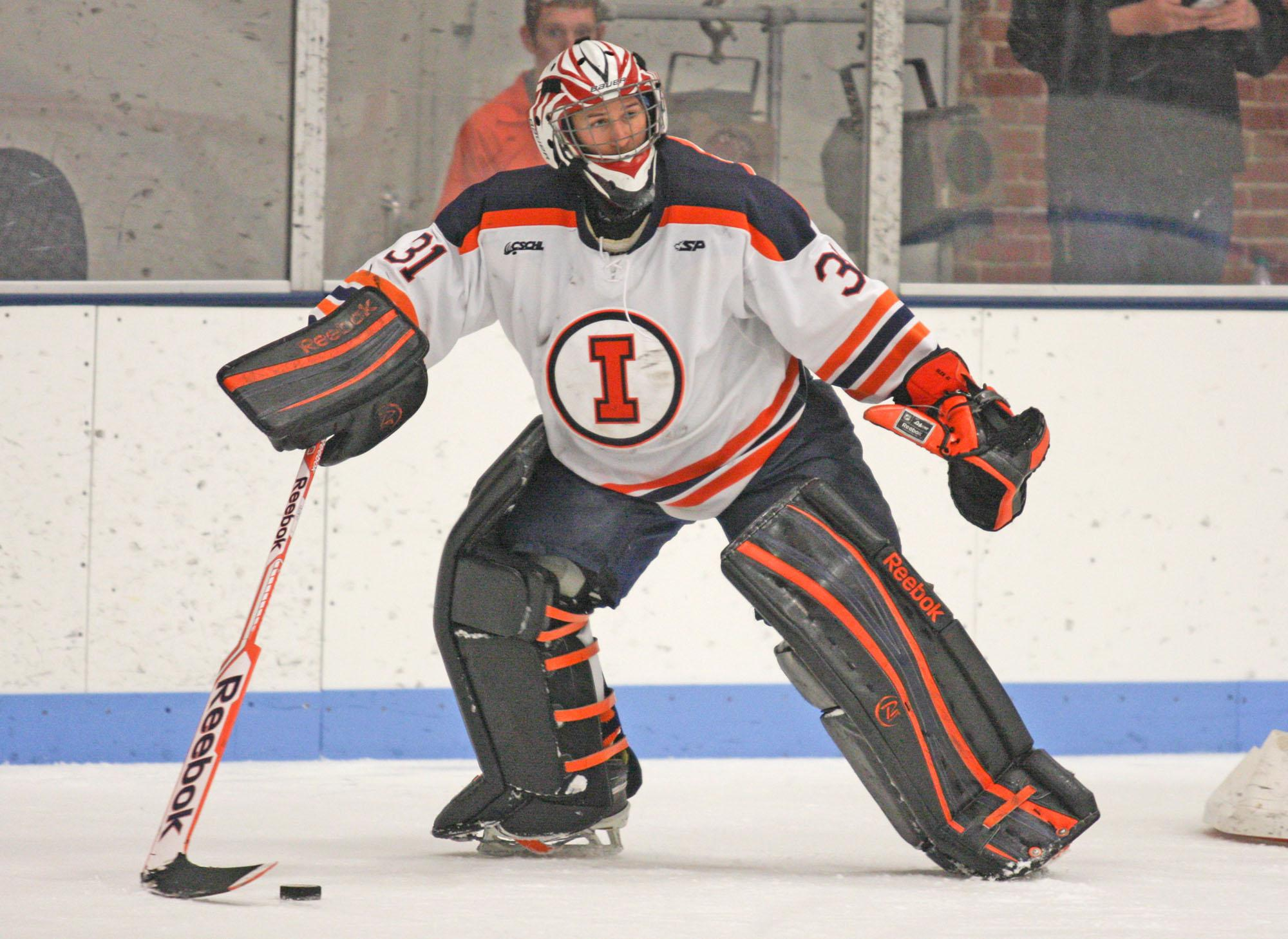 Illinois' Joe Olen (31) looks for somebody to pass the puck to during the Ohio hockey game at the Ice Arena on Friday, October 24, 2014. The Illini won 2-1.