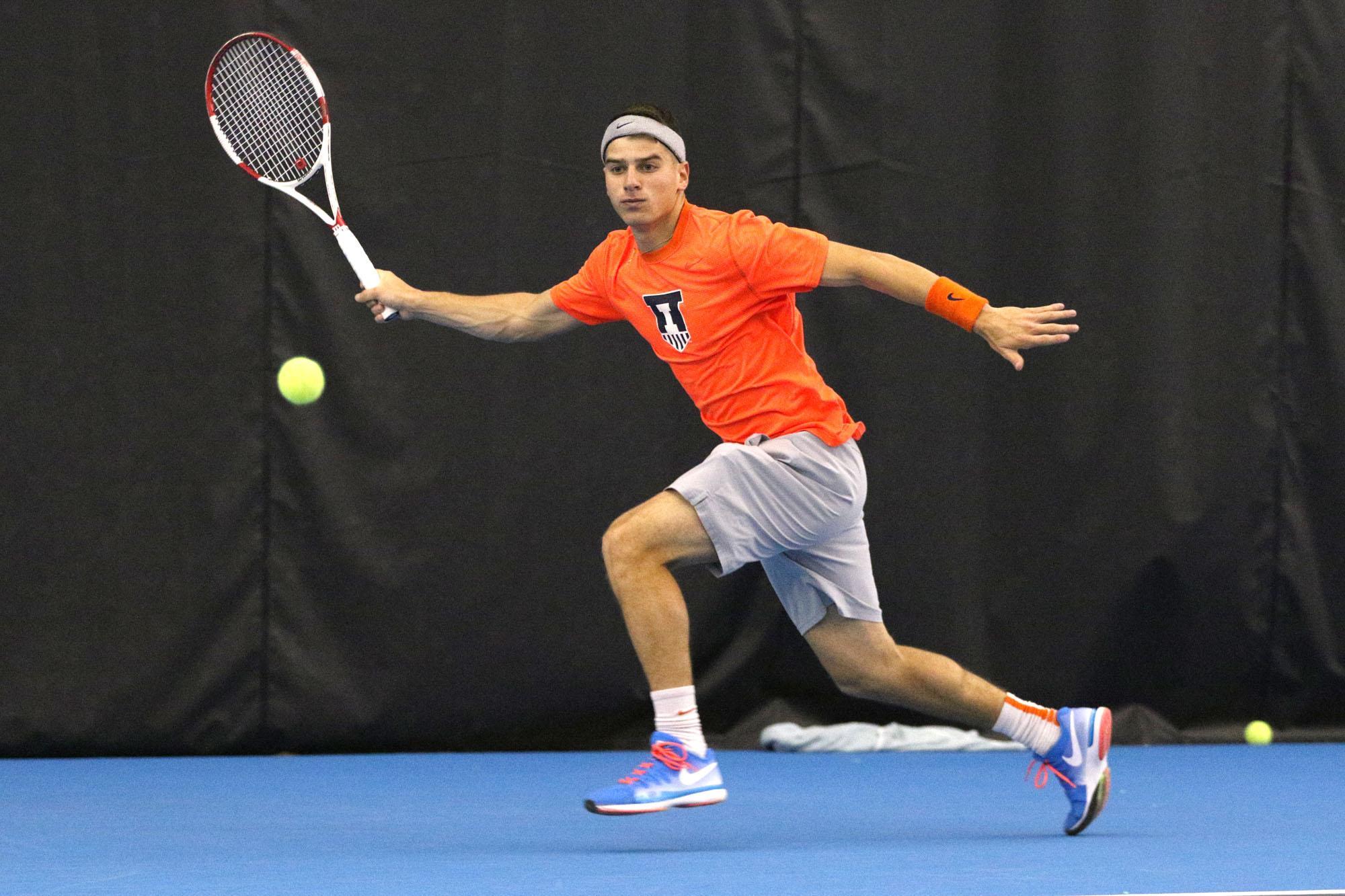 Illinois' Aron Hiltzik runs for the ball during the tennis game v. Ohio State at Atkins Tennis Center on Sunday, Mar. 29, 2015. Illinois won 4-0.