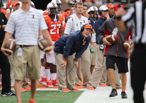 Illinois head coach Tim Beckmam reacts after having a referee decision go against Illinois during the game against Western Kentucky at Memorial Stadium on Saturday, Sept. 6, 2014. The Illini won 42-34.