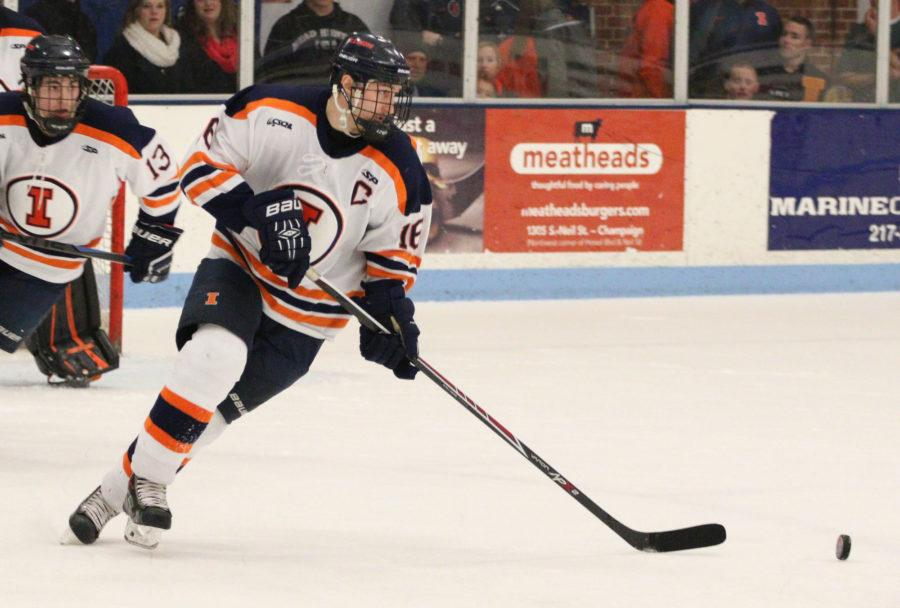 Illinois' John Olen (16) manuevers the puck down the rink during the hockey game vs. Robert Morris at the Ice Arena on Saturday, Jan. 24, 2015. The Illini lost 4-3.
