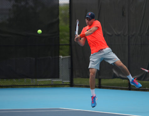 Illinois' Aron Hiltzik makes a return during the second round of NCAA Men's Tennis Regionals v. Drake at Khan Outdoor Tennis Complex on Saturday, May 9, 2015. Illinois won 4-2.