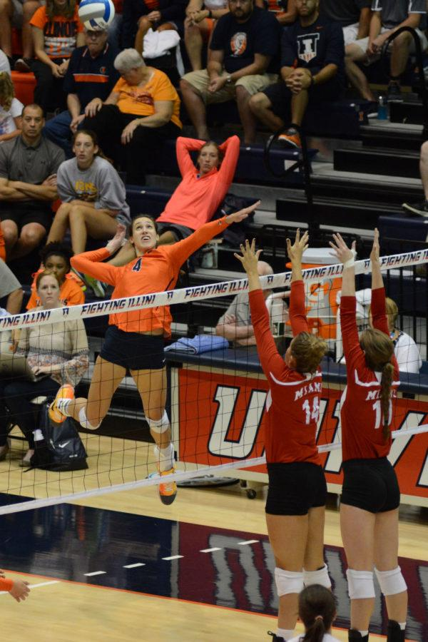Illinois' Michelle Strizak (4) attempts to spike the ball during the game versus Miami at Huff Hall on Saturday, August 29, 2015.The Illini won 3-0.